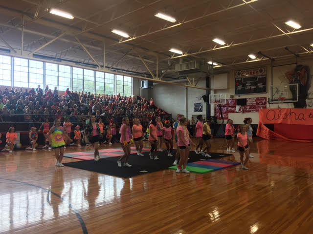 The+Pelahatchie+High+School+cheerleaders+dancing+with+the+band+at+the+first+pep-rally+August+18th.++Fun+cheers+and+dances+thrill+students+and+teachers%2C+and+the+cheerleaders+have+even+more+fun+entertaining+their+classmates.+Photo+Credit%3A+Kelsey+Williams%0A+%0A