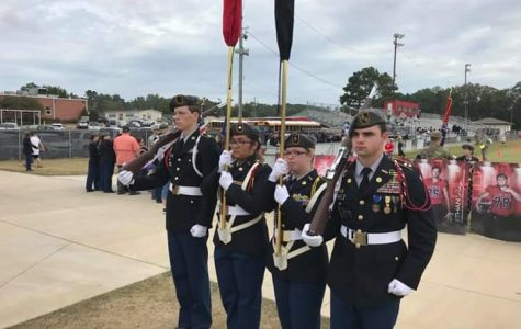 Pelahatchie JROTC competition color guard at Florence High School competing at the Capital Regions All Services Drill Championship .