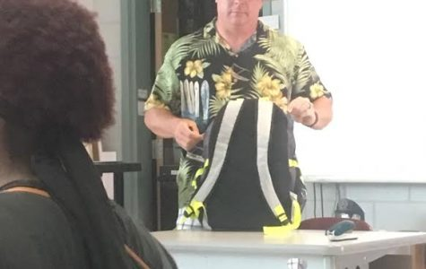 Jim Harrison, dressed in his Tacky Tourist attire, prepares for class.