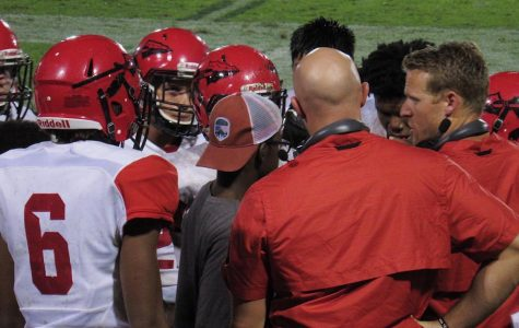 Chiefs in a huddle listening to Head Coach, Sam Williams. Photo taken by Abby Dawson