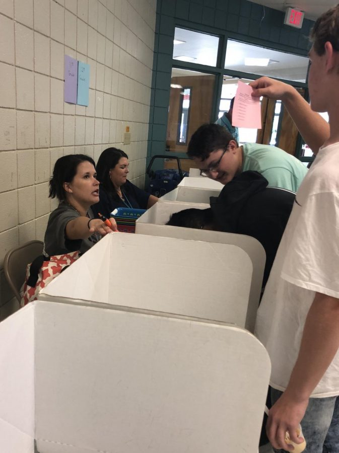 Mrs. Nobles and students at PHS vote for student council representatives.