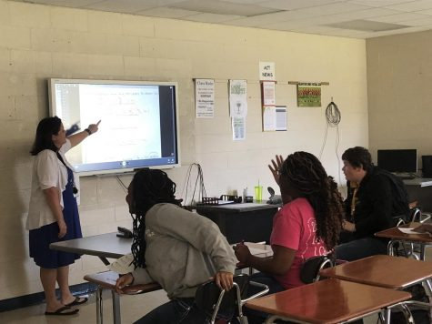 Nikki Nutt, the new ACT prep and Algebra 3 teacher, is busy teaching her third block algebra class.