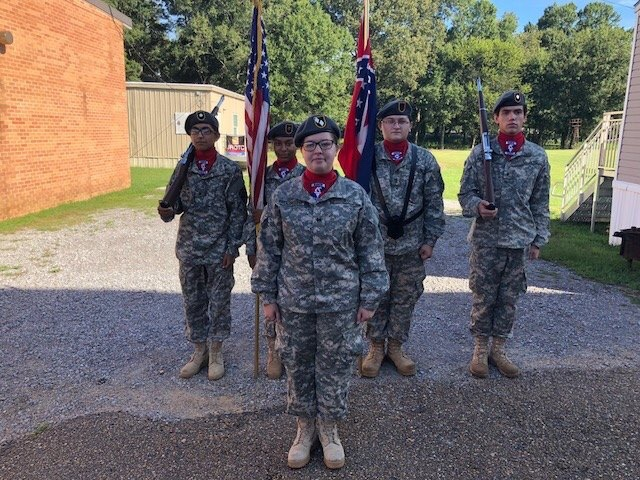 Photo taken by Colonel Hargett. Pelahatchie JROTC Color-Guard stands ready to go perform at the Muscadine Jubilee. Back row from left to right is Jose Banuelas, Brooke Johnson, Landin Pierce, and Gaven Boydstun; Jessica Smith stands in front.