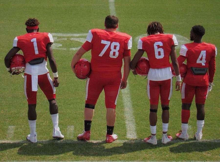 From left to right: JP Purvis, Gunner Till, Cedrick Wilder, Avery Lewis waiting on the coin toss before the legendary game. Photo Cred: Abby Dawson