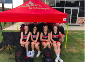 Mallory Shier, Haley Mills, Mckaylee Hester, and Meagan Herrington tailgate at the cheer tent before the game.