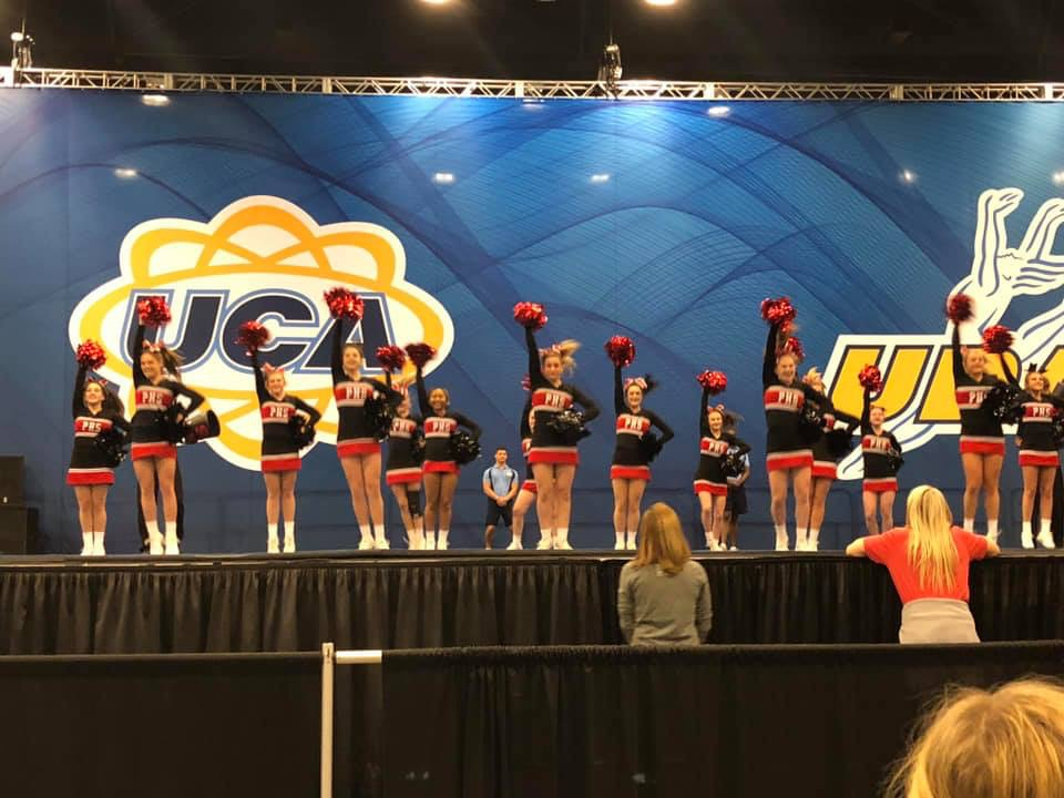 "This picture was snapped during the beginning of the routine when the cheerleaders danced to the music ""Sloopy."""