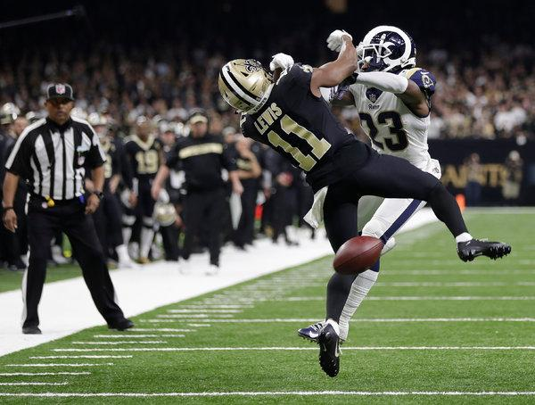 (Photo Courtesy ESPN) Rams' cornerback Nickell Robey-Coleman barrels into Saints' receiver TommyLee Lewis as the referee watches what will likely always be remembered as one of the worst no-calls in NFL history.