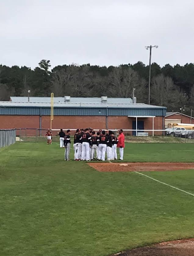 Baseball boys meet before the second game.
