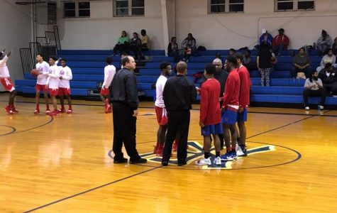 Chiefs' team captains Zay Taylor and Avery Lewis meet with game officials and North Forrest's team captains. Photo Credit: Teague Burchfield.