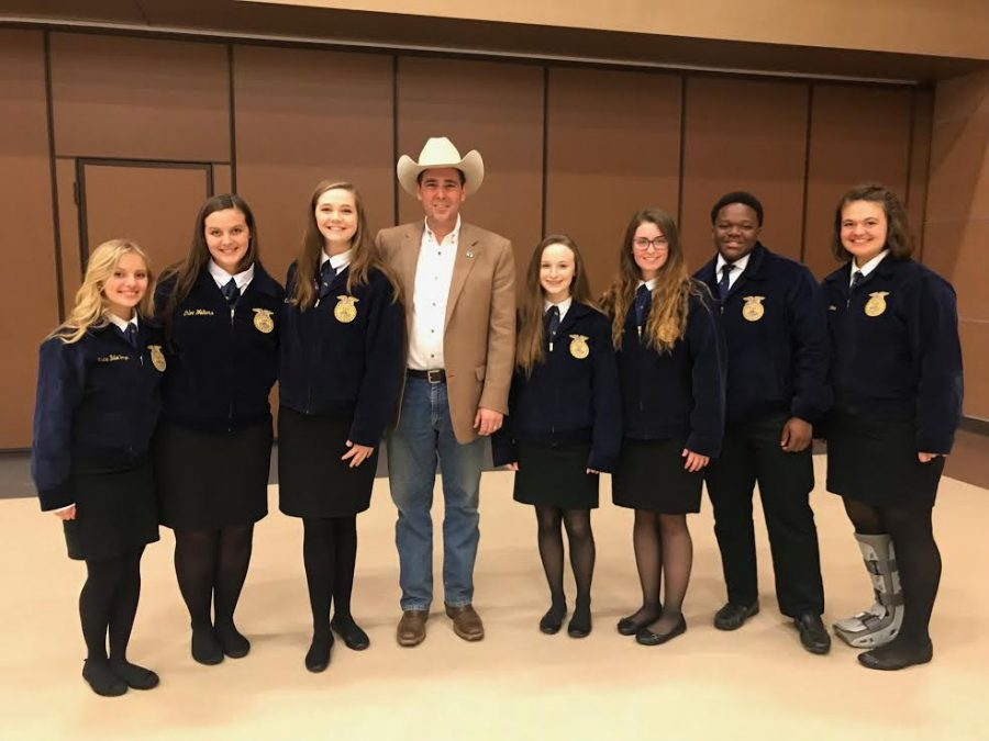 Commissioner Andy Gibson and Pelahatchie's opening and closing team Left to right: Katie Belle Boyer, Chloe Walters, Olivia Sirmon, Andy Gibson, Adlyn Till, Bella Attkinson, Justin Beeman, Anna Grace Carter.