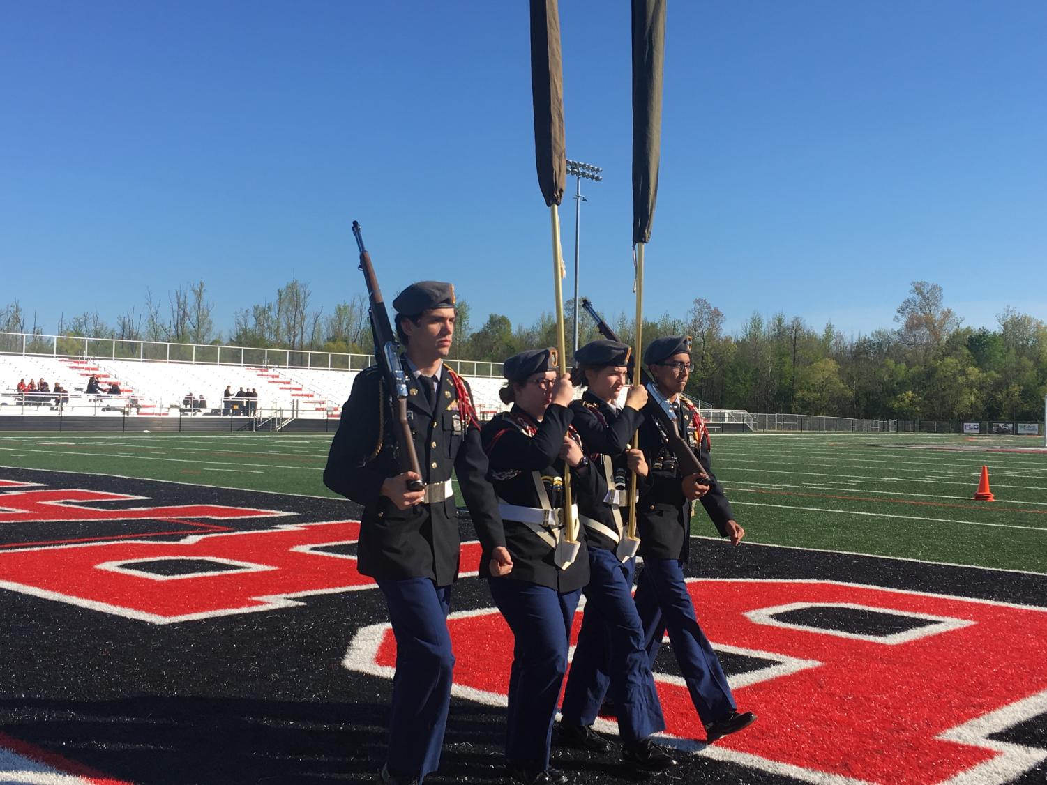 PHS JROTC cadets C/1LT Gaven Boydstun, C/LTC Jessica Smith (Commander of the color guard), C/SGT Madeline Pierce, and C/CPT Jose Banuelas entering the drill pad.
