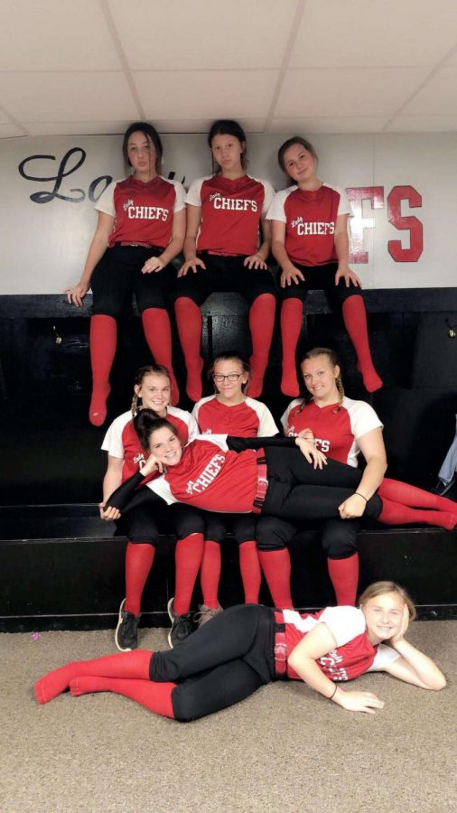 The girls (from left to right) Jaylene Waters, Zoey Laingley, Maggi Gilliam, Madelyn Cain, Marie Valentine, Julia Myers, Brooklyn Ferguson, and Aliya Ward wait in the softball locker room before games.