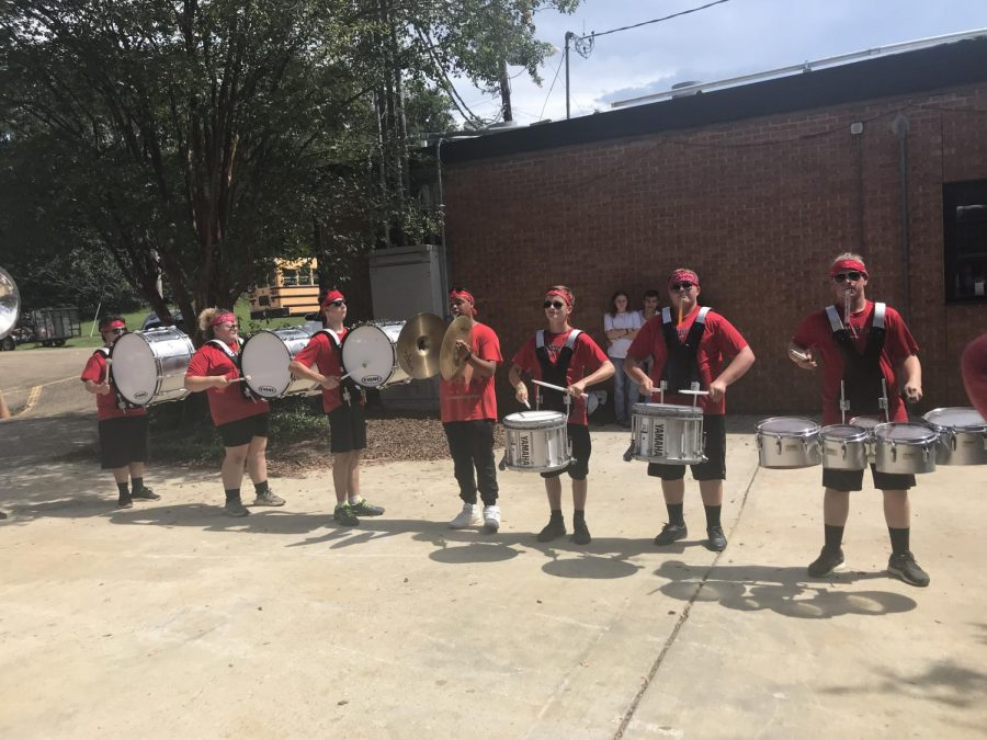 The drum line performs for students and faculty.
