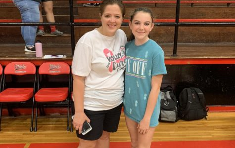Coach Nutt and player Shelbey Surkin pose for the camera at the varsity game on October 1.