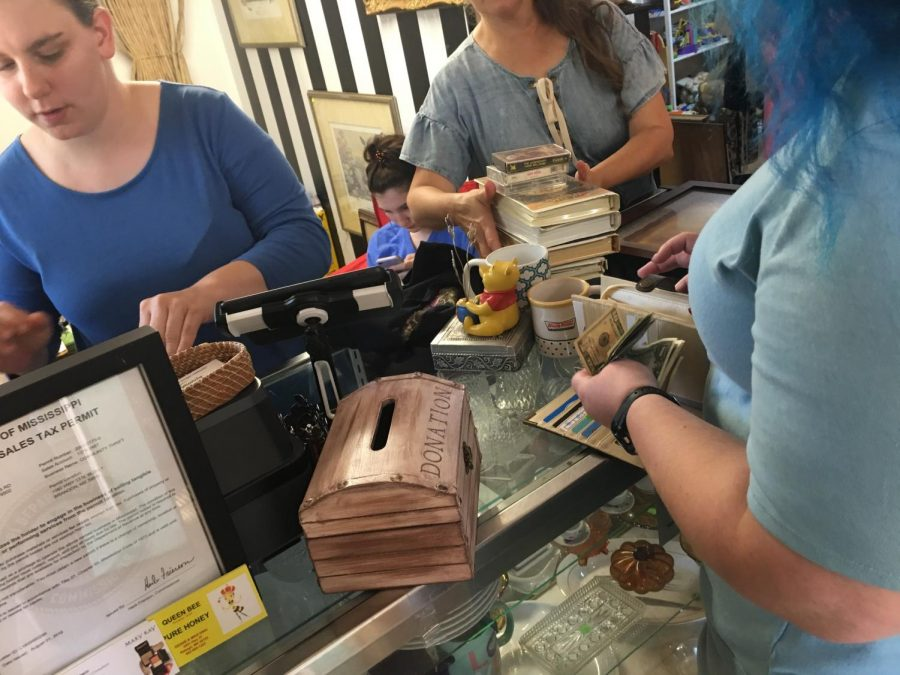 Deborah Pearson purchases knickknacks inside the thrift store, taking advantage of this special event.