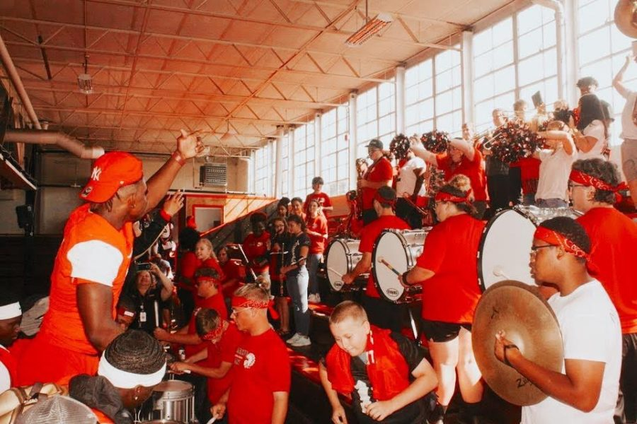 The band and several football players have a little fun as the pep-rally concludes on September 6.