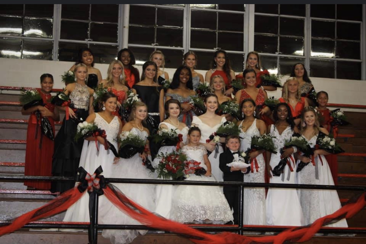 Junior high and high school maids take a group picture.
