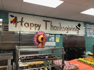 The cafeteria workers decorated the walls for Thanksgiving lunch with parents and elementary students.