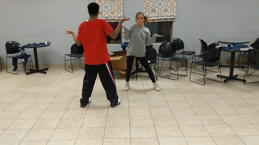 Chance Anding and Kaylee Collins working on the choreography for the song