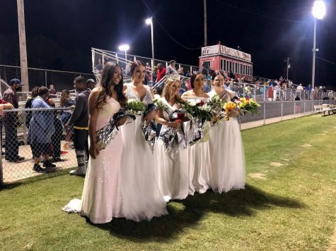 The senior homecoming maids pose with their queen Katie Bell Boyer after the crowning ceremony.