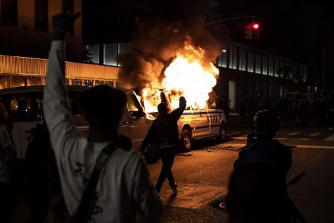 Protestors destroy police car in New York at a Black Lives Matter Riot in June of this past year.