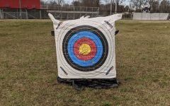 First year archery member impresses coach with a bullseye at Monday's practice before first archery match on Wednesday, February 10.