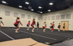 The new 2021-2022 cheerleading team members at their first practice work on jump drills to prepare for the upcoming season.