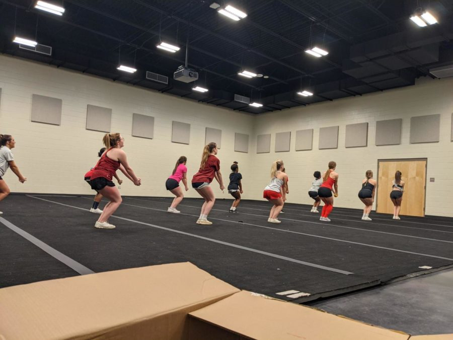 The+new+2021-2022+cheerleading+team+members+at+their+first+practice+work+on+jump+drills+to+prepare+for+the+upcoming+season.+