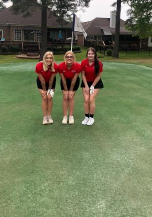 The PHS girl's golf team takes a photo to celebrate their excellent game they played on Wednesday April 7, 2021